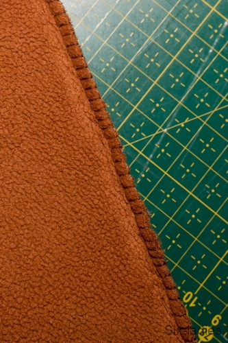 Overlockový steh - softshellové kalhoty po roce nošení